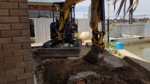 Excavating for pile cap heads